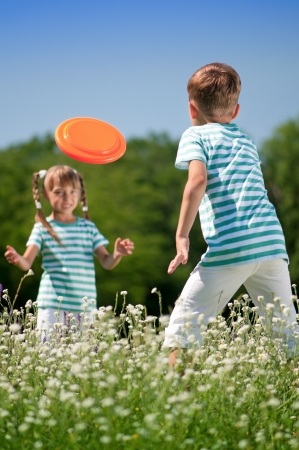 Children playing flying disc photo