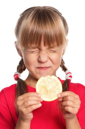 レモンを持つ少女 写真素材