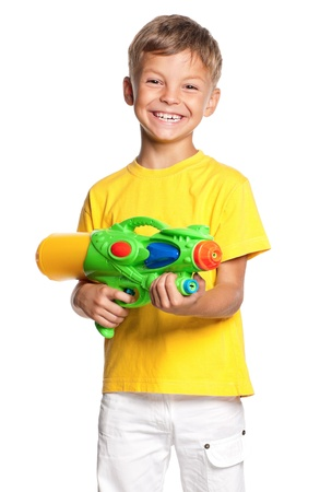 standing water: Boy with water gun