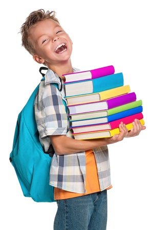 niños en la escuela: Muchacho con los libros Foto de archivo