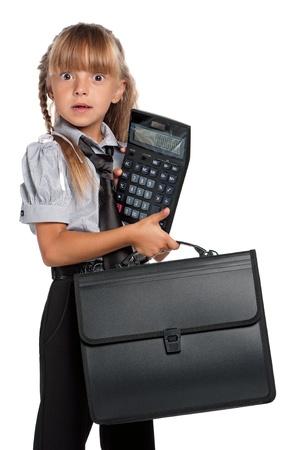 amateur: Ni�a con la calculadora Foto de archivo
