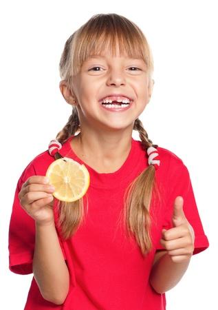 Little girl with lemon photo