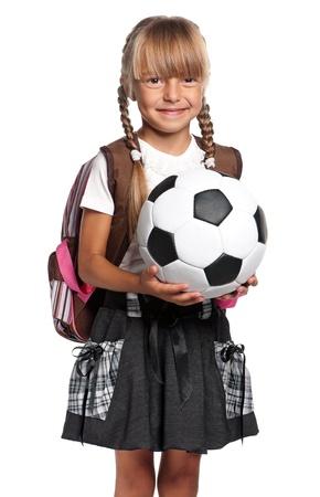 school sports: Little schoolgirl with soccer ball