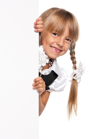 peek: Little girl with white blank Stock Photo
