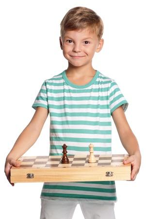 Boy mit Schachbrett Standard-Bild