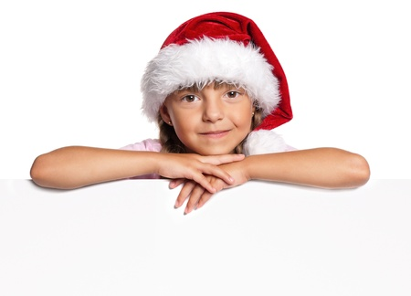 Little girl in Santa hat Stock Photo - 15691361