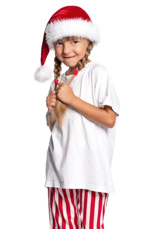 timidity: Little girl in Santa hat Stock Photo