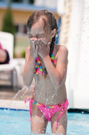 aquapark: Little girl in swimsuit