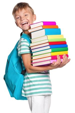 niños estudiando: Niño pequeño con los libros Foto de archivo