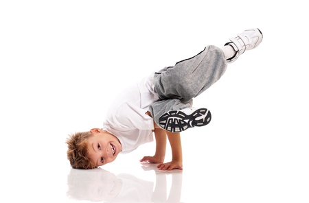 break dancer: Happy little boy dancing isolated on white background Stock Photo