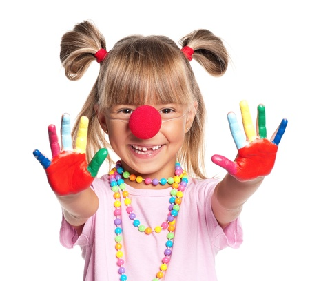 Portrait of happy little girl with red clown nose isolated on white background photo