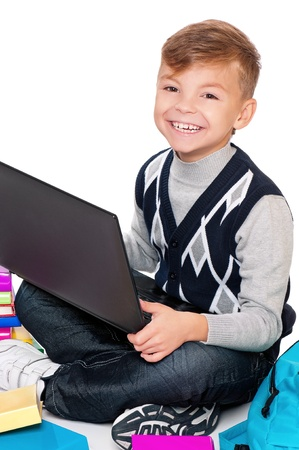 Boy with laptop and books photo