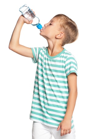 standing water: Boy with bottle of water