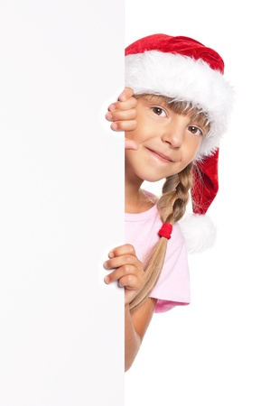 Little girl in Santa hat Stock Photo - 16594192