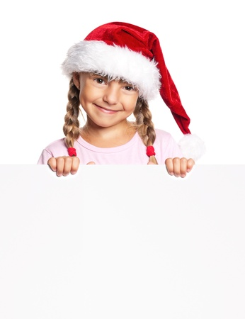 Little girl in Santa hat photo