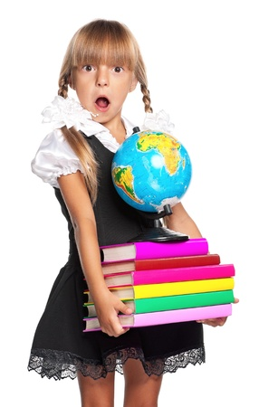 back to school: Little girl with globe and books