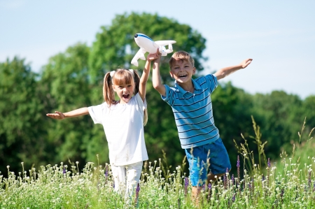 Happy children on meadow Stock Photo - 17567492