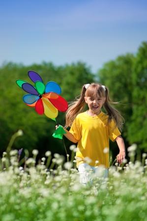 Happy girl with weathercock photo