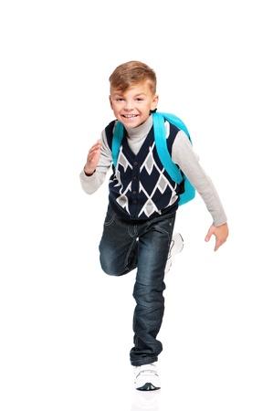 niños saliendo de la escuela: Boy con mochila