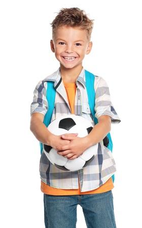 niño con mochila: Niño con pelota de fútbol