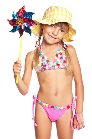 little girl smiling: Little girl in swimsuit