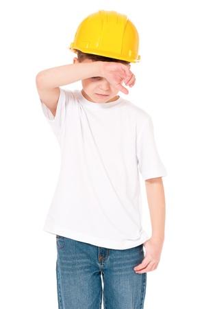 sad boy: Boy in hard hat