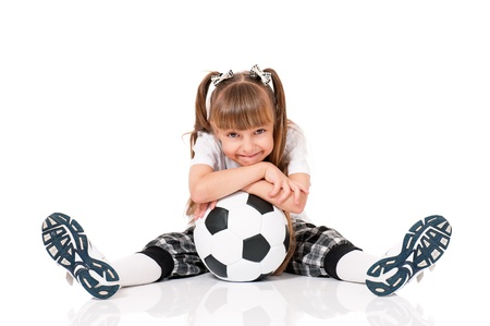 child ball: Little schoolgirl with soccer ball sitting on floor, isolated on white background Stock Photo
