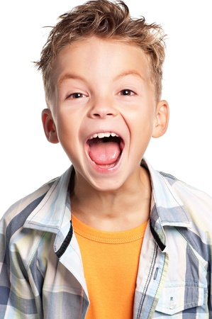 Close-up of portrait happy boy screaming, on white background