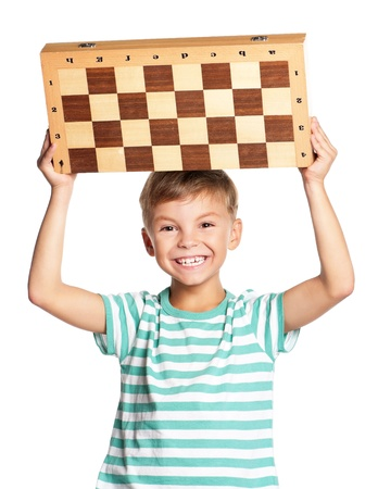 Boy with chessboard photo