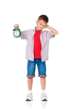 Boy with alarm clock photo