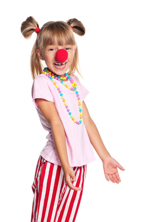 Little girl with red clown nose isolated on white background photo