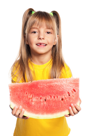 Little girl with slice of watermelon isolated on white background photo