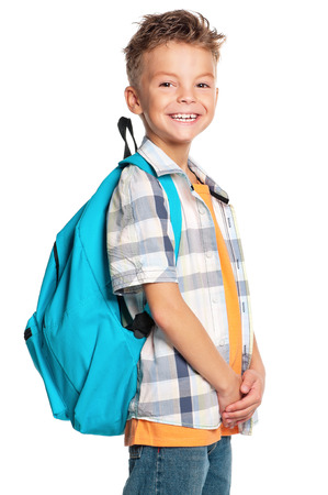 Portrait of a schoolboy with backpack, isolated on white background photo