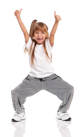 hip hop dance: Happy little girl dancing isolated on white background
