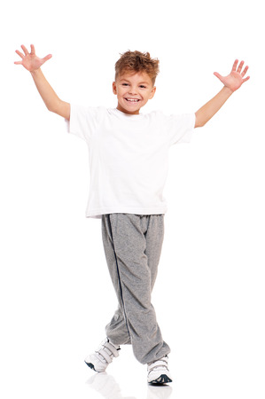 young boy feet: Happy little boy dancing isolated on white background Stock Photo