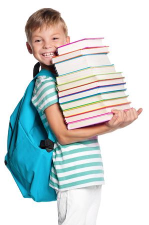 Happy little boy with books isolated on white background photo