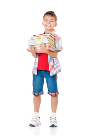 Happy schoolboy with books isolated on white background photo