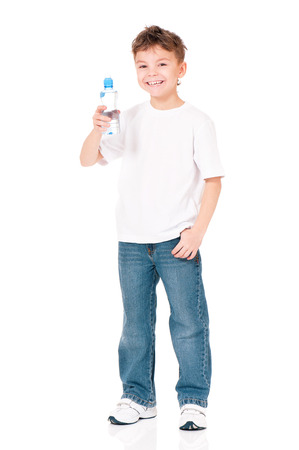 standing water: Happy boy with bottle of water isolated on white background