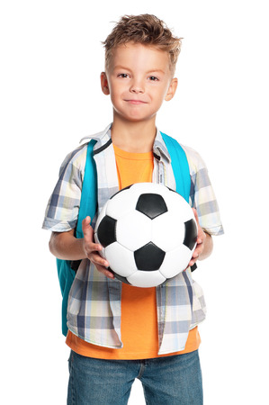 balls kids: Happy schoolboy with backpack and soccer ball, isolated on white background