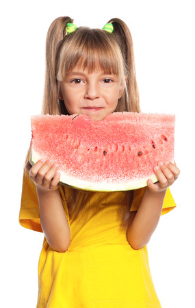 Little girl eating slice of watermelon isolated on white background photo
