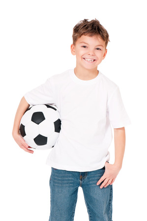 Happy boy in white T-shirt with soccer ball, isolated on white background Stock Photo - 27258736