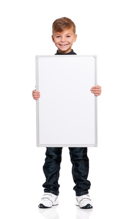 Happy boy showing blank placard board, isolated on white background Stock Photo - 27258738