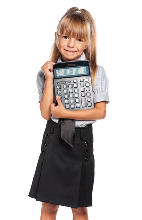 Little girl in school uniform with calculator isolated on white background photo
