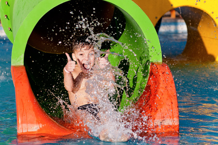 Boy at aqua park Stock Photo