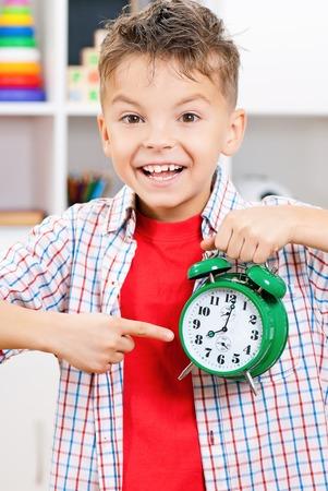 Boy with alarm clock photo