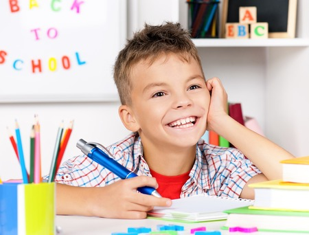 Boy doing homework photo
