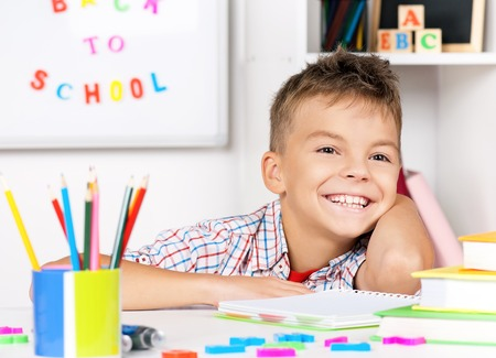 young cheering: Boy doing homework