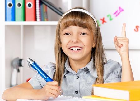 happily: Girl doing homework