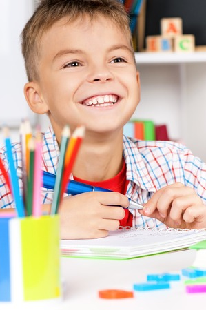 homework student: Boy doing homework