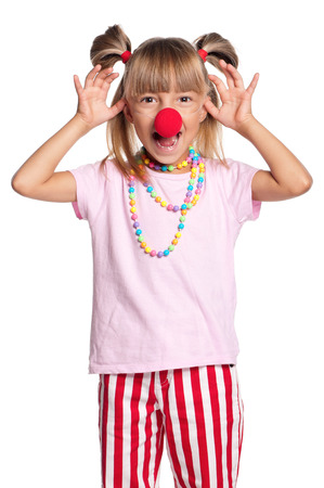 clown nose: Happy little girl with red clown nose, isolated on white background Stock Photo